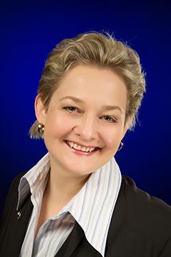 Business Portrait mit blauem Hintergrund